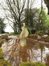 A pond or a water feature is transformed with sculpture, especially in the winter.